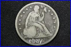 1859-O Seated Liberty Dollar. Very Good